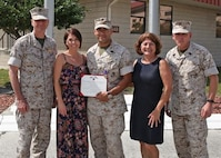 Master Sgt. Adrian M. Marquez Ayala is presented the Purple Heart medal by Lieutenant. Gen. William D. Beydler, Mar. 17, 2016, at a ceremony at MacDill Air Force Base, Fla. Marquez received the Purple Heart for injuries he sustained on 8 November 2004, during Operation PHANTOM FURY in Fallujah, Iraq. Marquez is currently assigned to Wounded Warrior Battalion, Tampa Detachment. Beydler is the commander of Marine Corps Forces Central Command.