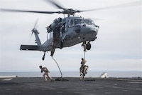 U.S. Marines with Fox Company, 2nd Battalion, 1st Marine Regiment and the Maritime Raid Force with the 13th Marine Expeditionary Unit, fast rope from a CH-60 Seahawk with Helicopter Sea Combat Squadron 23 aboard the USS Boxer off the coast of southern California during their Sustainment Exercise Jan. 17, 2016. SUSTEX is designed to reinforce the Boxer Amphibious Ready Group/MEU's execution of mission essential tasks in preparation for their upcoming deployment.