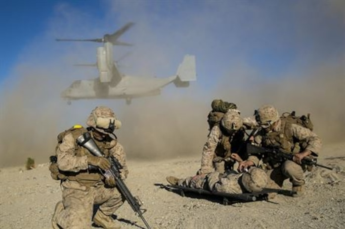 U.S. Marines with Battalion Landing Team 2/1, 13th Marine Expeditionary Unit (MEU), shield a simulated casualty from the debris of a U.S. Marine Corps MV-22 Osprey during Composite Training Unit Exercise (COMPTUEX) at Marine Corps Air Ground Combat Center Twentynine Palms, California, Oct. 30, 2015. COMPTUEX provides the MEU ARG the opportunity to integrate naval training while also allowing focused, mission-specific training and evaluation for the Marines and their Navy counter parts.