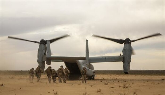 U.S. Marines with Charlie Company, 1st Battalion 7th Marine Regiment, Special Purpose Marine Air-Ground Task Force-Crisis Response-Central Command, recover a simulated casualty as part of a Tactical Recovery of Aircraft and Personnel exercise at an Undisclosed Location in Southwest Asia Jan. 12, 2016. SPMAGTF-CR-CC is ready to respond to any crisis response mission in theater to include the employment of a TRAP force.