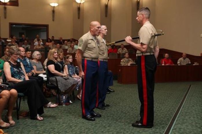 United States Marine Corps Forces, Central Command bid farewell to its senior enlisted leader and welcomed another during a relief and appointment ceremony held at the Davis Conference Center aboard Air Force Base MacDill, in Tampa, Fla., June 30. Sergeant Maj. William T. Thurber replaced Sgt. Maj. Lawrence P. Fineran as sergeant major of MARCENT. Lieutenant Gen. William D. Beydler, MARCENT commander, presided over the event, that also doubled as a retirement ceremony for Fineran.