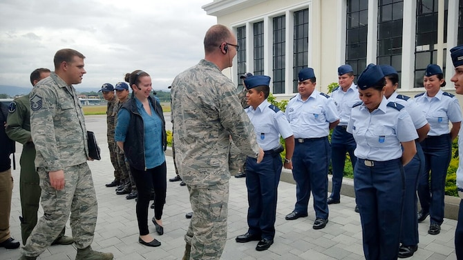 Lt. Col. Eric Corder, assistant director of operations for the 225th Air Defense Squadron, greets members of the Guatemalan Air Force Aug. 25, 2017.  As part of the State Partnership Program visit, Corder leveraged his 28 years of air defense expertise to provide feedback about the functionality and validity of the Guatemalan national air defense network.  The SPP links a state's National Guard with the armed forces of a partner country in a cooperative, mutually beneficial relationship by means of tailored, small footprint, high-impact security cooperation engagements that foster long-term enduring relationships with U.S. friends and allies around the world.  The SPP arose from a 1991 U.S. European Command decision to pair reserve component soldiers and airmen with the armed forces of the then newly formed nations of the Baltic Region following the collapse of the Soviet Bloc. (U.S. Air Force photo by Major Alexander Hau)