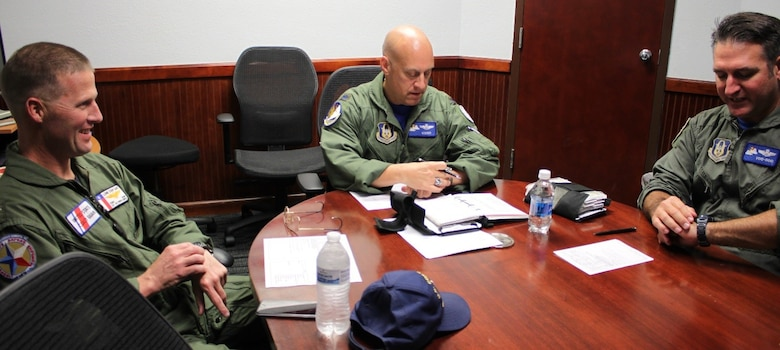 CUTLINE: Lt. Col. Andrew Kissinger (center) and Maj. Andrew Van De Walle (right), 39th Flying Training Squadron, prepare for a familiarization flight for visiting U.S. Coast Guard Commander Capt. Tony Hahn (left). The USCG Corpus Christi sector commander/air station commanding officer reached out to the 39th FTG to discuss pilot retention/recruiting and reserve integration benefits. (Photo by Debbie Gildea, 340th Flying Training Group Public Affairs).