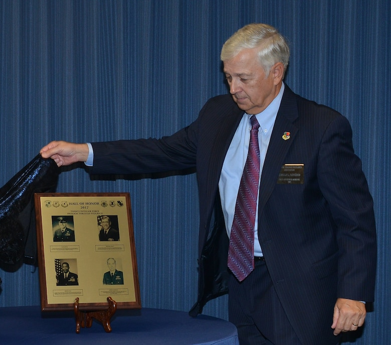 Retired Col. Ronald Haygood, president, Freedom Through Vigilance Association, unveils the 2017 Hall of Honor plaque.