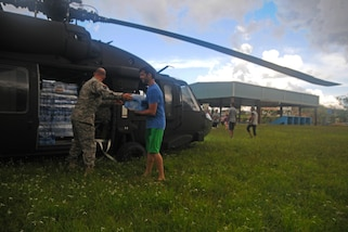 New York National Guardsmen, along with the Puerto Rico National Guard, brought water to a community affected by Hurricane Maria at Lares, Puerto Rico, Oct. 4, 2017. Puerto Rico National Guard photos by Spc. Agustín Montañez