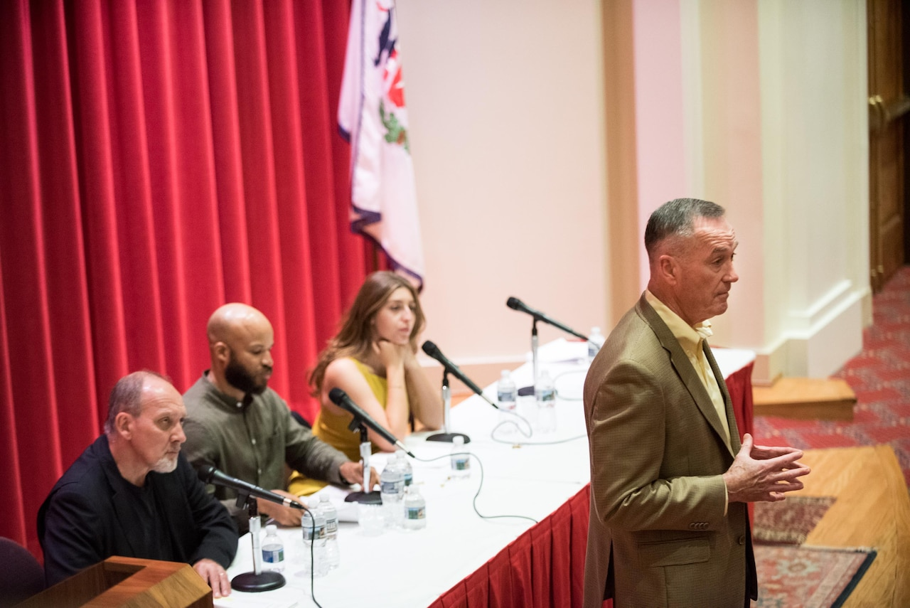 Marine Corps Gen. Joe Dunford, chairman of the Joint Chiefs of Staff, hosts a presentation of the Theatre of War play for senior officers, senior enlisted leaders and their spouses at the National War College.