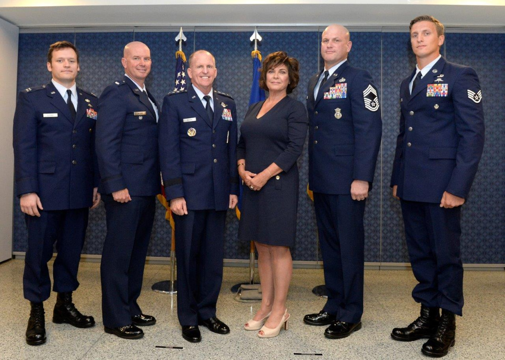 Air Force Vice Chief of Staff Gen. Stephen W. Wilson and Janine Sijan Rozina, Lance P. Sijan's sister, poses for a photo with the 2016 Lance P. Sijan U.S. Air Force Leadership Award winners in the Pentagon, Arlington, Va., Oct. 5, 2017. Sijan was shot down over Vietnam, Nov. 9, 1967, and evaded capture for 45 days despite severe injuries. He later died while in a Vietnamese prisoner-of-war camp and was presented the Medal of Honor posthumously for heroism. (U.S. Air Force photo by Staff Sgt. Rusty Frank)
