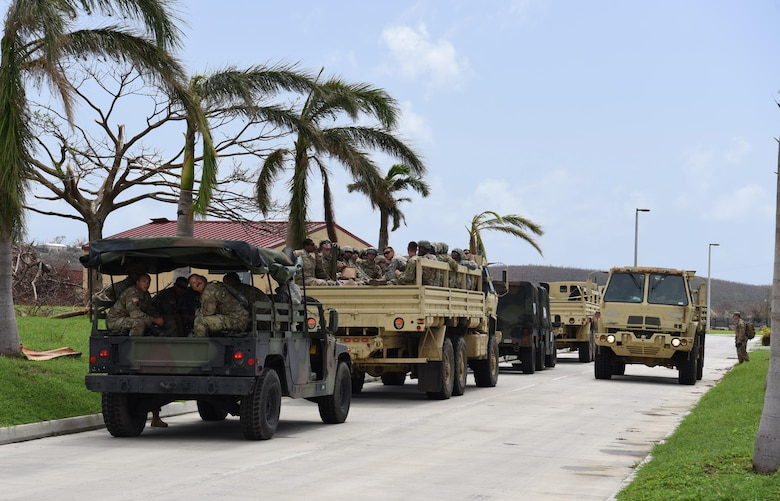A National Guard convoy rolls out of the armory in St. Croix, U.S Virgin Islands in order to provide aid to the local community, September 28, 2017. Hurricane Maria left many on the island without food or water. (U.S. Air National Guard photo by Tech. Sgt. Gregory Ferreira/Released)