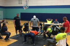 Hoffmaster competes in a bench pressing competition.