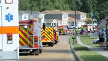 Families watch the different fire trucks pass by Sept. 30, 2017, in Magnolia Village on Columbus Air Force Base, Mississippi, and the surrounding communities. The trucks and vehicles, from Columbus AFB and surrounding communities' fire departments, participated in a parade as part Fire Prevention Week. (U.S. Air Force photo by Staff Sgt. Christopher Gross)