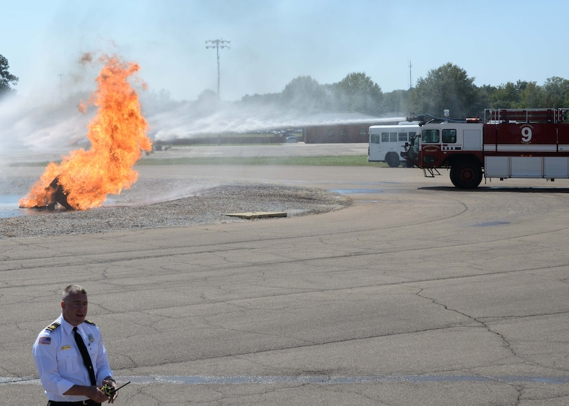 William O'Meara, Assistant Chief of Health and Safety for fire and emergency services, narrates a simulated aircraft crash Sept. 30, 2017, on Columbus Air Force Base, Mississippi. A P-19 Stryker firetruck was used to extinguish the burning wreckage. The P-19 holds 1,500 gallons of water, 500 gallons of foam and has a top speed of 72 miles per hour. (U.S. Air Force photo by Airman 1st Class Beaux Hebert)