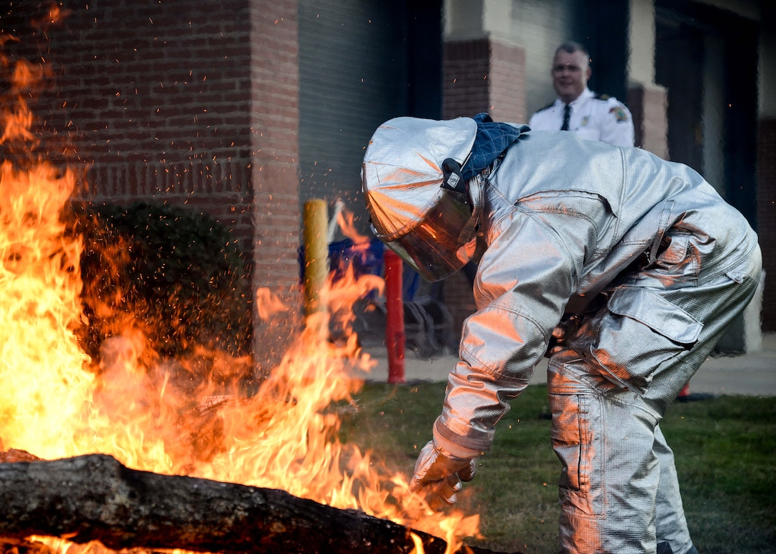 Airman Michael Cargile, 14th Civil Engineer Squadron firefighter, uses a shovel to take coals from a fire and place them in a barbeque pit Sept. 29, 2017, on Columbus Air Force Base, Mississippi. The Columbus AFB Fire Department hosted a s'mores roast and played an informational video for families during Fire Prevention Week Sept. 25-30. (U.S. Air Force photo by Airman 1st Class Beaux Hebert)