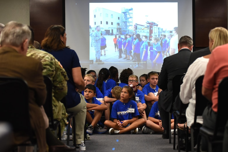 Students of STARBASE await the ribbon cutting ceremony at the STARBASE Goodfellow building on Goodfellow Air Force Base, Texas, Oct. 4, 2017. STARBASE, a Department of Defense program, teaches students science, technology, engineering and mathematics programs, showing them career possibilities for their future. (U.S. Air Force photo by Airman Zachary Chapman/Released)
