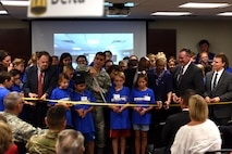U.S Air Force Col. Ricky Mills, 17th Training Wing commander, Howard Taylor, San Angelo Museum of Fine Arts director, and with students cut the ribbon, signifying the opening to STARBASE at the STARBASE building on Goodfellow Air Force Base, Texas, Oct. 4, 2017. STARBASE enrolls students from both San Angelo and Goodfellow AFB. (U.S. Air Force photo by Airman Zachary Chapman/Released)