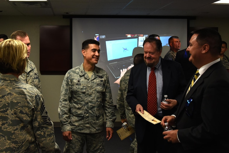 U.S. Air Force Col. Ricky Mills, 17th Training Wing commander, talks with Howard Taylor, San Angelo Museum of Fine Arts director, after the ribbon cutting ceremony for STARBASE at the STARBASE building on Goodfellow Air Force Base, Texas, Oct. 4, 2017. San Angelo Museum of Fine Arts is the tertiary funder for STARBASE. (U.S. Air Force photo by Airman Zachary Chapman/Released)