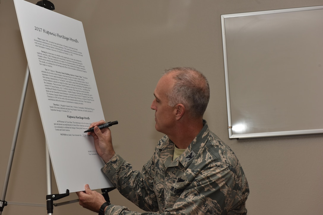 U.S. Air Force Col. Mark Ely, 509th Bomb Wing vice commander, signs the Hispanic Heritage Month proclamation Sept. 26, 2017, at Whiteman Air Force Base, Mo