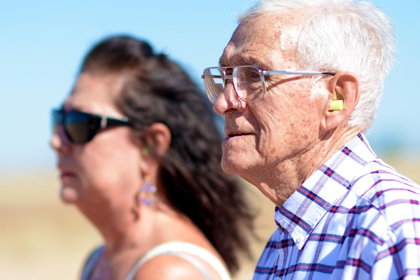 Manuel Martinez, a World War II veteran, and his family watch fighter jet takeoffs during a tour at Luke Air Force Base, Ariz., Oct. 2, 2017. Martinez was able to see first-hand how Luke builds the future of airpower. (U.S. Air Force photo by Senior Airman Devante Williams)