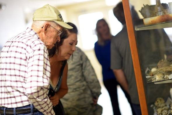 Manuel Martinez, a World War II veteran, and his family view artifacts from Gila Bend Air Force Auxiliary Field during a tour of the 56th Range Management Office at Luke Air Force Base, Ariz., Oct. 2, 2017. Martinez spent the morning reminiscing about his time at the base decades ago and learned about how the Air Force runs today. (U.S. Air Force