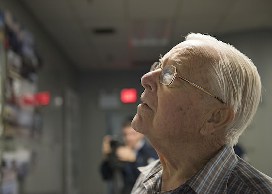 George Prentiss, a Korean War and Air Force veteran, stares at the timeline wall in the 92nd Maintenance Group Heritage Room at Fairchild Air Force Base, September 29, 2017. Team Fairchild gave Prentiss a tour of the 92nd MXG building as part of his bucket list. (U.S. Air Force photo by Airman 1st Class Jesenia Landaverde)
