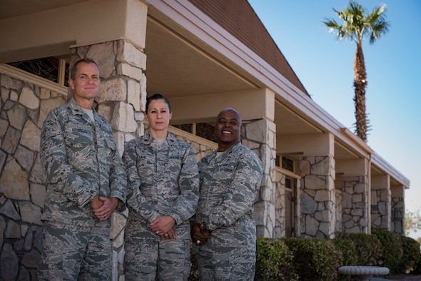 Maj. Kelvin Francis, 99th Air Base Wing chaplain, Maj. Kimberly Lane, 99th Medical Operations Squadron clinical social worker, and Lt. Col. Dwayne Jones, 99th Air Base Wing chaplain, stand in front of the base chapel at Nellis Air Force Base, Nev., Oct. 5, 2017. They are part of the Nellis Disaster Mental Health team that provides services to anyone affected by the recent Las Vegas shooting. (U.S. Air Force photo by Airman 1st Class Andrew D. Sarver/Released)