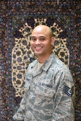 Tech. Sgt. Siddartha Sosa-Rodriguez, NCO in charge of plans and programs with the 380th Air Expeditionary Wing Chapel, poses for a photo at Al Dhafra Air Base, United Arab Emirates, Oct. 4, 2017.