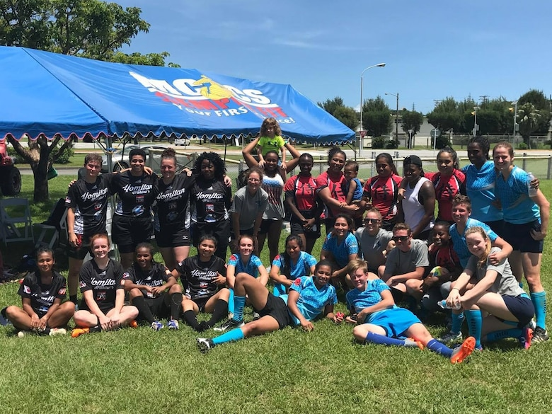 The Camp Foster Sharks pose for a picture
