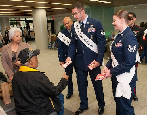 Joint Base San Antonio Air Force Ambassadors  Tech. Sgt. Steven Nowicki and Tech. Sgt. Jacqueline I. Crow pass out valentines at the Valentines for Vets event at the Veterans Affairs hospital in San Antonio in 2016.
