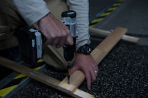 U.S. Air Force Tech. Sgt. Daniel McDermott (right), 435th Construction and Training Squadron transportation flight superintendent, screws a nail into a wall stand being used for a Halloween haunted house at Ramstein Air Base, Germany, Oct. 5, 2017. The haunted house is being constructed hosted by members of the 435th Construction and Training Squadron, 1st Combat Communications Squadron, 1st Air and Space Communications Operations Squadron and 435th Contingency Response Squadron, for the base populace to enjoy.