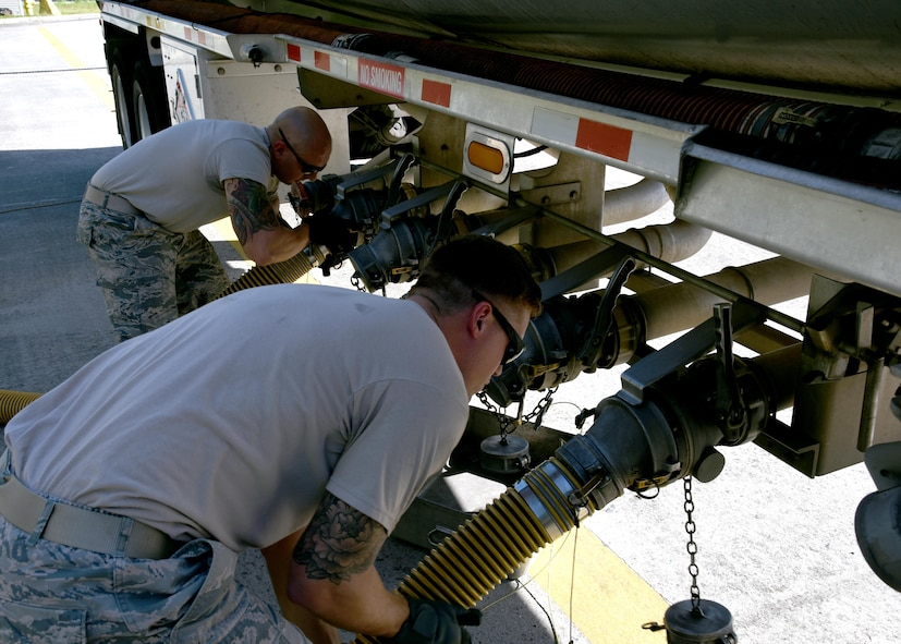 Fuels Distribution System Technicians, Staff Sgt. Justin Bradford, a volunteer from the 134th Air Refueling Wing, McGhee Tyson Air National Guard Base (left) and Staff Sgt. Jared Dabney, 165th POL, operate a truck offloading header valve to take fuel during a fuel delivery to the Savannah Air National Guard Base, Oct. 4, 2017.