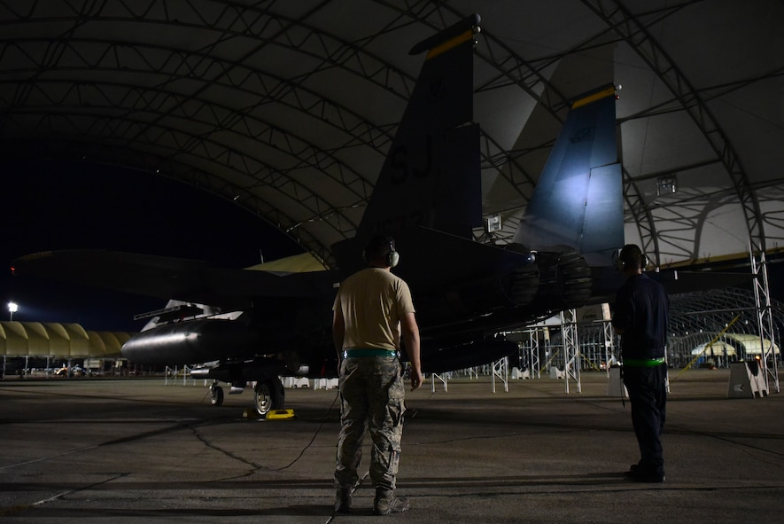 Members of the 4th Aircraft Maintenance Squadron perform routine inspection on an F-15E Strike Eagle, Oct. 6, 2017, at Seymour Johnson Air Force Base, North Carolina.