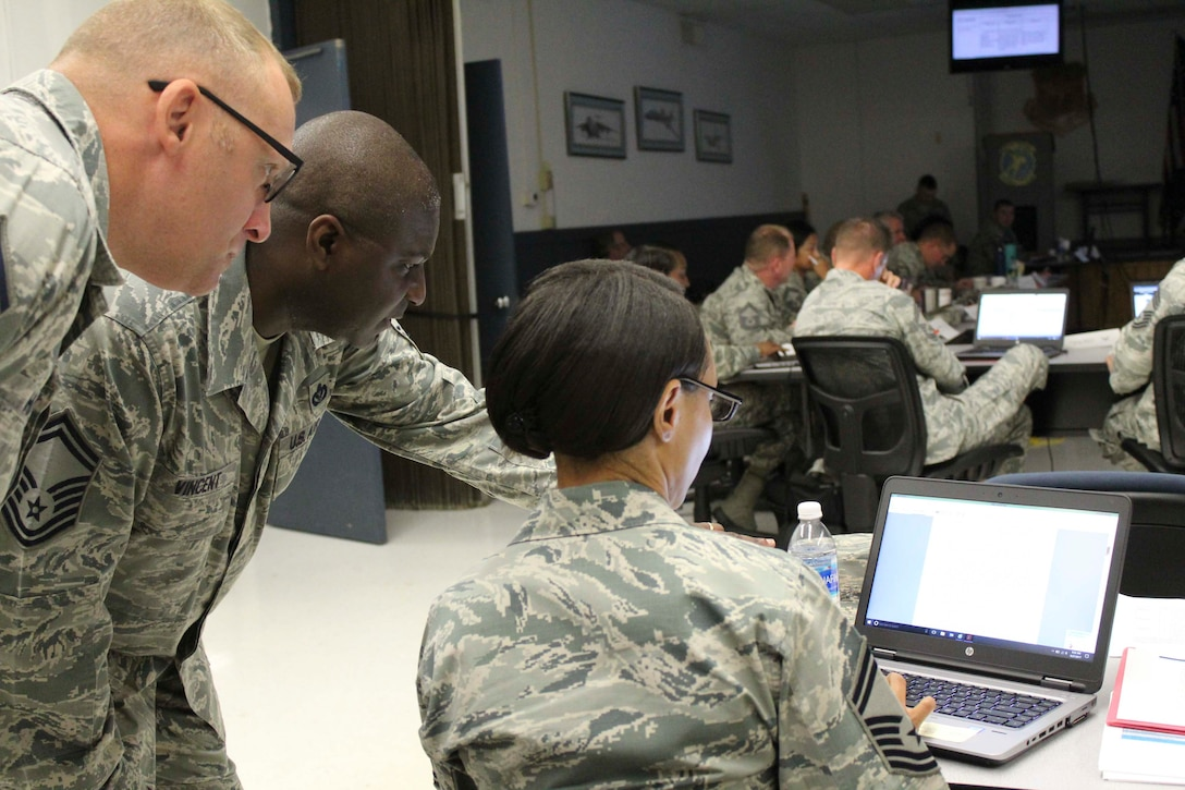 AFCEC force development team members discuss potential changes to engineer training requirements during a recent Strategic Training Requirements Team meeting at Ft. Leonard Wood, Missouri. The group collaborated with major command leaders, Air National Guard and Air Force Reserve teams to develop new training requirements. (U.S. Air Force Photo by Susan H. Lawson)