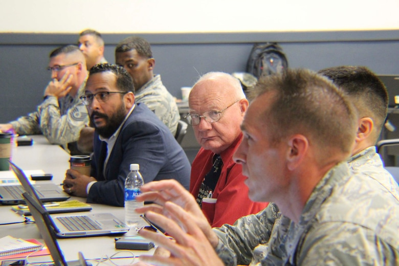 Chief Master Sgt. Larry Blume, civil engineer major command functional manager at AFMC, discusses the impact potential changes to engineer training can have on Airmen. Blume was part of a team comprised of members from AFCEC force development, major command leaders, Air National Guard and Air Force Reserve. The Strategic Training Requirements Team meeting at Ft. Leonard Wood, Missouri, provided a venue to develop new training requirements for Air Force specialty code 3E5s. (U.S. Air Force Photo by Susan H. Lawson)