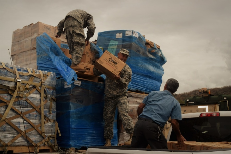 Soldiers assist the Federal Emergency Management Agency to deliver relief supplies to the residents of Puerto Rico.