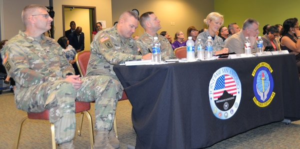 From left) Brig. Gen Jeffrey Johnson, commander, Brooke Army Medical Center; Maj. Gen. Mark Stammer, commander, U.S. Army South; Maj. Gen. Thomas Tempel, commander, Regional Health Command-Central; Brig. Gen. Heather Pringle, commander, 502nd Air Base Group and Joint Base San Antonio; and Capt. William Leonard, deputy commander, Navy Medicine Education and Training Command, listen during the report out session of the Armed Forces Action Program members annual forum, held at the Installation Management Command Academy Oct. 3-6.