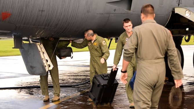 Aircrew retrieve their equipment from a B-52 Stratofortress upon arrival at Fairford Royal Air Force Base, U.K., Sept. 14, 2017.