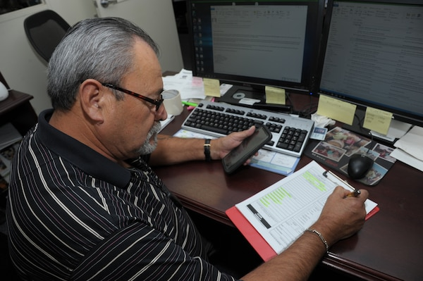 Armando Lerma, 502nd Logistics Readiness Squadron, chief of operations writes all information on the Air Force Form 440, bomb threat questioner, during a building bomb threat exercise, Sept. 28, 2017 at Joint Base San Antonio-Randolph. The primary purpose of the internal LRS exercise is to practice building evacuation and remind employees the location of their primary and alternate rally points.  ( U.S. Air Force photo by Joel Martinez)