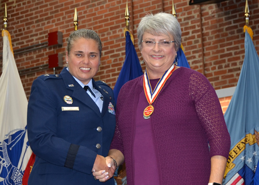 Defense Logistics Agency Aviation's Commander Air Force Brig. Gen. Linda Hurry inducted Carolynn Michel as the 35th DLA Aviation Hall of Fame recipient during a ceremony Sept. 27, 2017 in the Frank B. Lotts Conference Center on Defense Supply Center Richmond, Virginia.