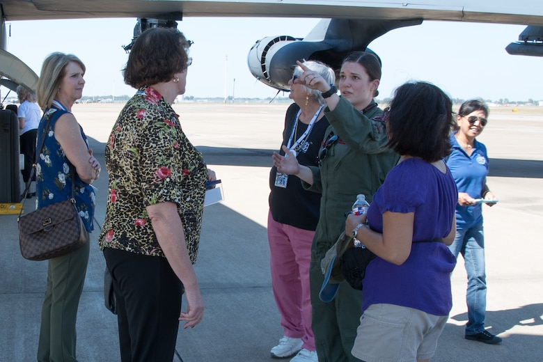 1st Lt. Christina Bowen, a Weapons System Officer assigned to the 11th Bomb Squadron, points out features of the B-52 Stratofortress during a tour for the Shreveport Chapter of Ninety-Nines on Barksdale Air Force Base, La. Oct. 6, 2017.
