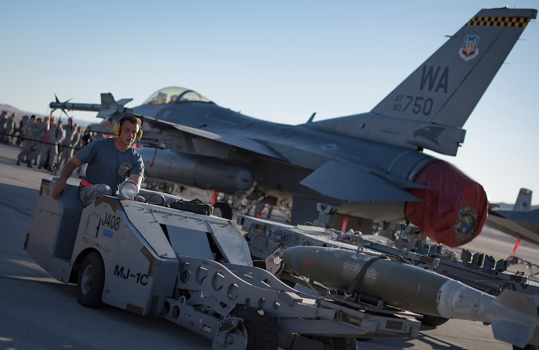An Airman from the 57th Maintenance Group prepares a missile assembly on an F-16 Fighting Falcon, assigned to the 16th Weapons Squadron, during a load crew competition Oct. 6, 2017, at Nellis Air Force Base, Nev. Multiple squadrons participated in the competition which tested their speed and accuracy when loading munitions onto an aircraft. (U.S. photo by Airman 1st Class Andrew D. Sarver/Released)