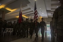 U.S. and Philippine Marines march colors during KAMANDAG opening ceremony