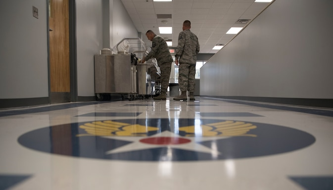 U.S. Air Force Airmen from the 130th Airlift Wing pick up lunch in the newly remodeled dining facility Oct. 7, 2017 at McLaughlin Air National Guard Base, Charleston, W.Va. New booth seating, furniture, custom tile floors, and new paint are some of the updates patrons enjoyed visiting the facility. The goal in the remodel was to provide Airmen a sense of the rich history of the 130th AW. (U.S. Air National Guard photo by Tech. Sgt. Eugene Crist)