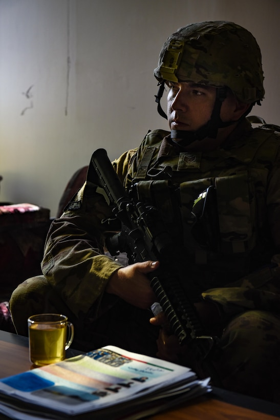 Staff Sgt. Chris O'Neil, 438th Air Expeditionary Wing chaplain assistant and Train, Advise, Assist Command-Air air advisor, listens in during a meeting with Afghan National Army Col. Abdul Basir, Religious and Cultural Affairs officer with the Afghan Air Force, Sept. 14, 2017, in Kabul, Afghanistan. During advising meetings outside a secured base, O'Neil provides security for the chaplain, who as a non-combatant does not carry a weapon. (U.S. Air Force photo by Staff Sgt. Alexander W. Riedel)