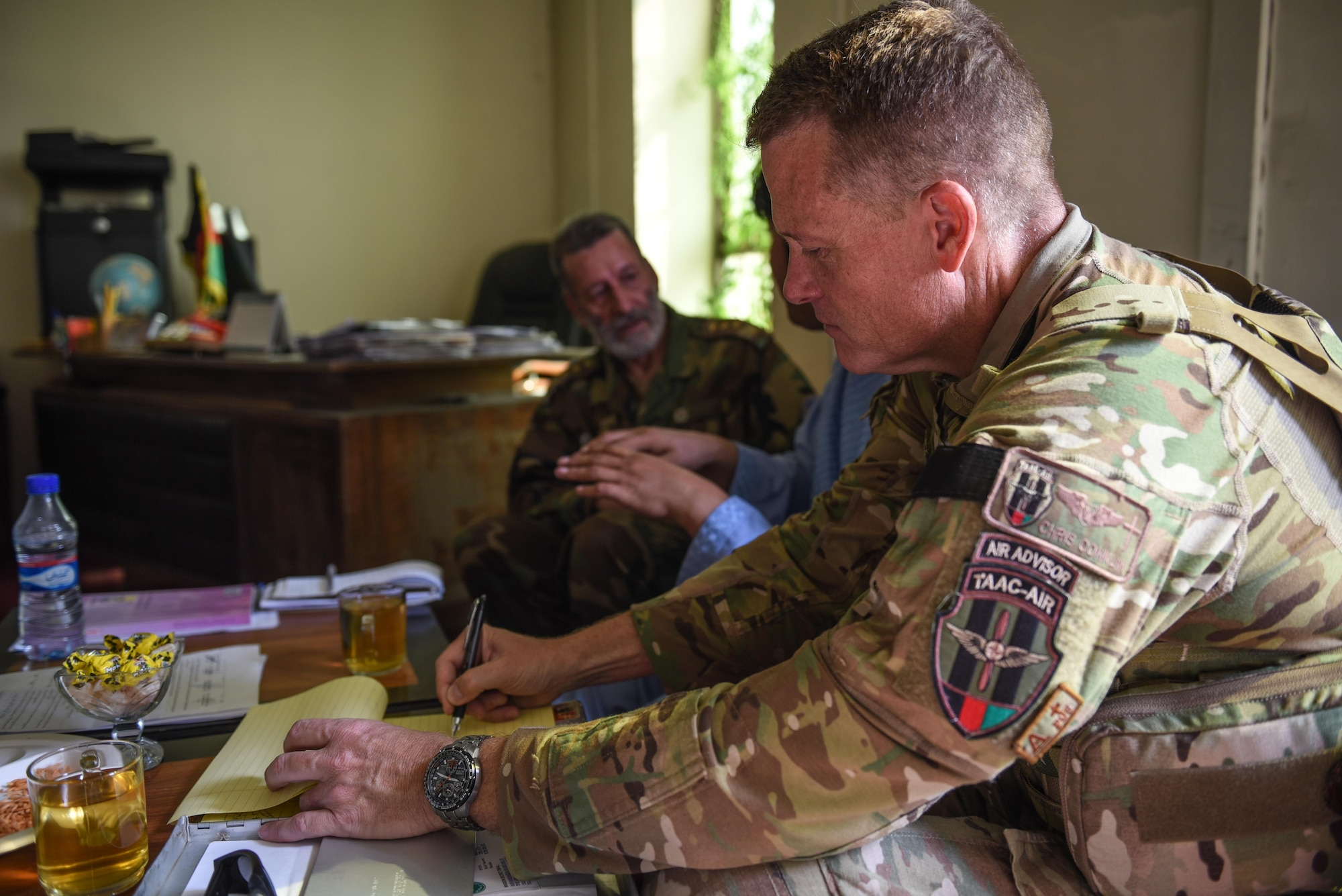 Chaplain (Maj.) Chris Conklin, Train, Advise, Assist Command-Air air advisor (right), takes notes during a meeting with Afghan National Army Col. Abdul Basir, head of the Afghan Air Force Religious and Cultural Affairs office, Sept. 14, 2017, in Kabul, Afghanistan. Conklin provides coordination and advice on the organization of religious support in the developing Afghan Air Force. (U.S. Air Force photo by Staff Sgt. Alexander W. Riedel)