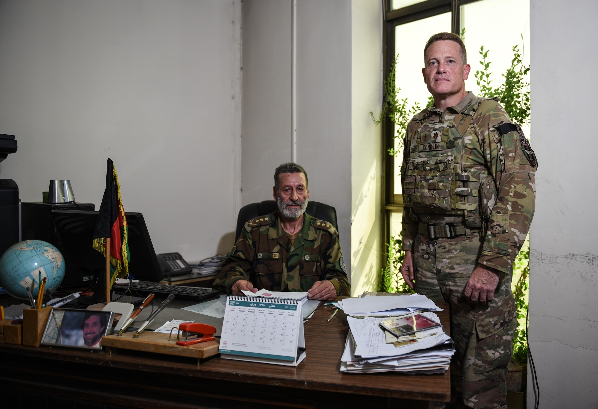 Chaplain (Maj.) Chris Conklin, Train, Advise, Assist Command-Air air advisor, (right) stands next to Afghan National Army Col. Abdul Basir, the head of the Afghan Air Force Religious and Cultural Affairs office, Sept.14, 2017, in Kabul, Afghanistan. Conklin provides training, assistance and advice on the organization of religious support in the developing AAF as the first air advisor chaplain in TAAC-Air. (U.S. Air Force photo by Staff Sgt. Alexander W. Riedel)