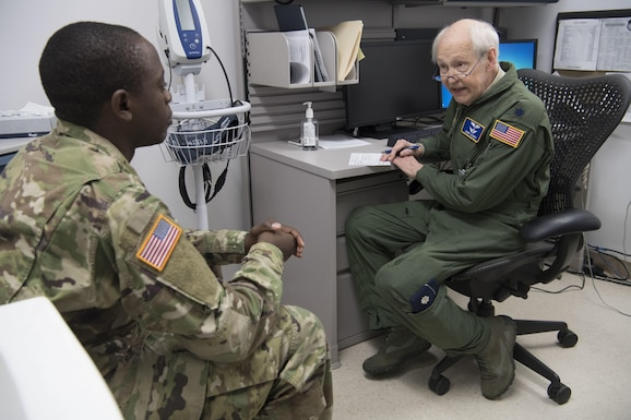 Lt. Col. John Lackey meets with a patient.