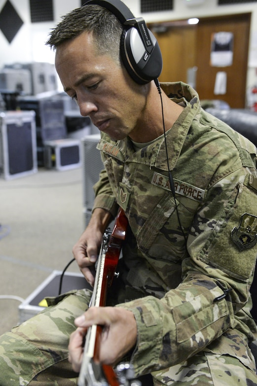 U.S. Air Force Tech. Sgt. John Kukan, non-commissioned officer in charge and guitar player assigned to the Air Force Central Command Band, Touch-n-Go, plays during a recording session as the band recorded their punk rock rendition of the Air Force Song at Al Udeid, Air Force Base, Qatar, Sept. 21, 2017.