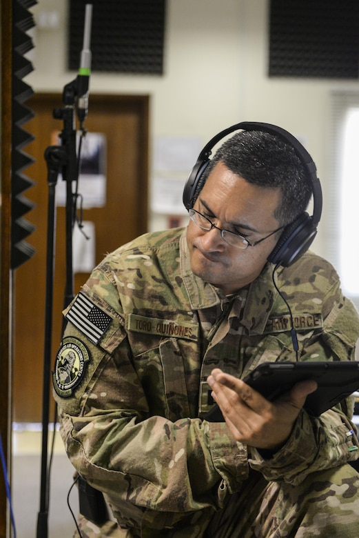 U.S. Air Force Capt. Rafael Toro-Quinones, officer in charge assigned to the Air Force Central Command Band, Touch-n-Go, listens to the band during a recording session where the band recorded their punk rock rendition of the Air Force Song at Al Udeid, Air Force Base, Qatar, Sept. 21, 2017.