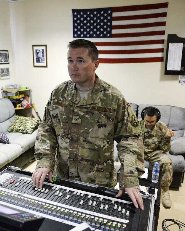 U.S. Air Force Tech. Sgt. John Marsh, audio engineer assigned to the Air Force Central Command Band, Touch-n-Go, adjusts sound levels during a recording session as the band recorded their punk rock rendition of the Air Force Song at Al Udeid, Air Force Base, Qatar, Sept. 21, 2017.