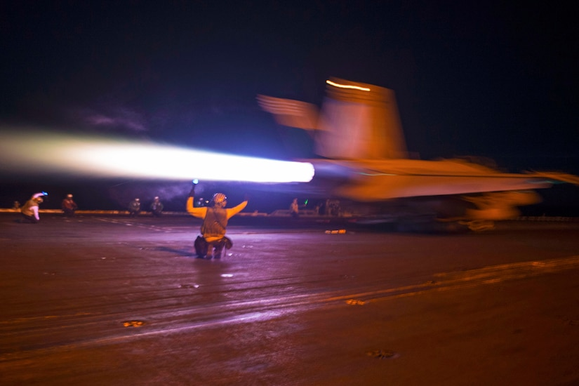 An F/A-18F Super Hornet launches from the flight deck of the aircraft carrier USS Nimitz.