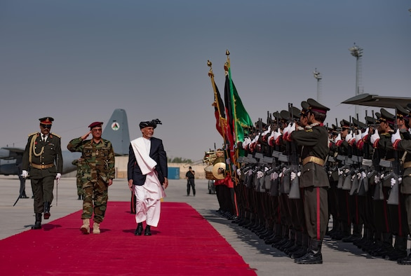 Afghanistan President Ashraf Ghani passes in review of Afghan National Security and Defense Force honor guard Oct. 7, 2017, at Kandahar Airfield, Afghanistan. Ghani ceremonially cut the ribbon officiating the arrival of the first two UH-60A Black Hawk helicopters to the Afghan Air Force fleet. (U.S. Air Force photo by Staff Sgt. Alexander W. Riedel)